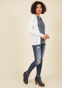 <p>Each night, you dreamed of a white cardigan to slip over your favorite ensembles. Then, one day, you awoke to this delicate layer. With pointelle accents, cable-knit-inspired patterns, and a scalloped hem, this sweet sweater answered your call with everything you hoped for and more.</p>