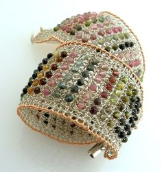 beads and wire crochet. my fingers would probably be bleeding after making this... but, it's so pretty.