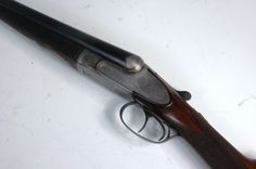 "Auguste Francotte of Liege - A Belgian 12 bore sidelock ejector, serial No.38322, having 28.5"" barrels stamped Joseph Whitworths fluid compressed steel, signed to the sight Auguste Francotte Brevete a Liege, the lockplate profusely engraved with bold floral and acanthus scrolls, chequered walnut stock and numbered 38322."