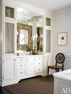 A 19th-century Dutch mirror glitters above the sink in J. Randall Powers's Houston bath | Architectural Digest