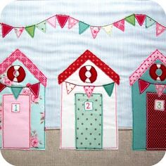 A lovely example of beach huts and bunting from Jenny Arnott Textiles