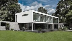 Contemporary House with Moat on the South Coast of England by AR Design Studio