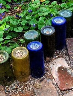 1000 ideas about wine bottle garden on pinterest for Recycling wine bottles creatively