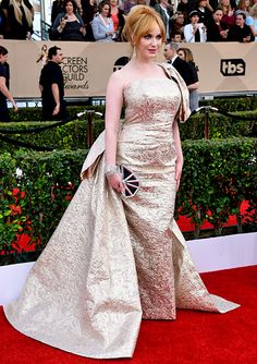 WORST: Christina Hendricks Let's have a moment of silence, shall we? This shiny brocade, half-sleeve situation just didn't work, even on a stylish star like Christina Hendricks. Celebrity Red Carpet, Celebrity Dresses, Celebrity Style, Strapless Dress Formal, Formal Dresses, Sag Awards, Christina Hendricks, Red Carpet Dresses, Celebs