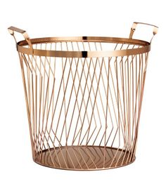 Copper-colored. Large metal wire basket with two handles at top. Height 9 1/2 in., diameter 10 1/2 in.