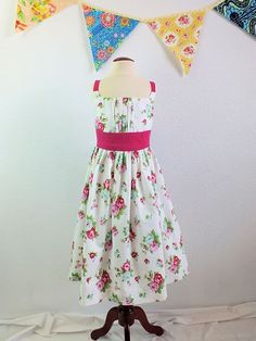 Girls boutique sun dress in designer fabric by TheMulberriBush.  This would be a beautiful dress for a wedding or party! @jennifer byrne paganelli