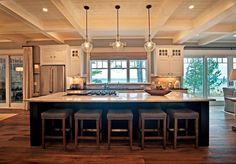 This Traverse City, Michigan lake home designed by KP Designs & Associates is so warm and inviting, I'd never want to leave! The home definitely hints at the lake setting with its rustic …