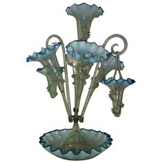 England  late 19thC  A rare and unusual Stourbridge Victorian art glass epergne, This model has 5 fluted tulips with two glass canes with hanging baskets.