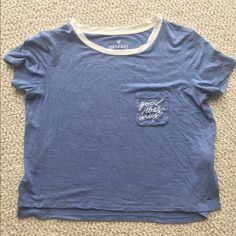 """American Eagle """"Good Vibes Only"""" tee A nice, calming color of blue (almost…"""