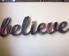 #Believe universe themed painting on laser cut wood edged with silver glitter. #lasercut #wood #universe #space #planets #iwanttobelieve #spraypaint #decore #decoration #deville #todayswork by deville90210