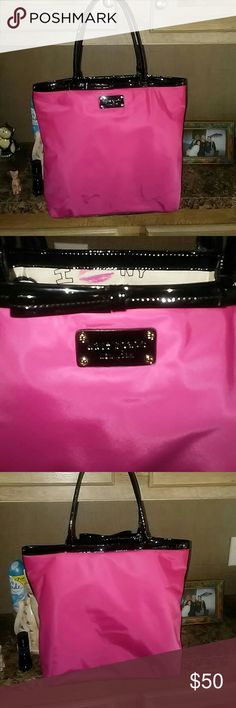 Kate Spade Purse Pink and black Kate Spade purse in excellent used condition medium in size! The inside of the purse is cute has no stains what-so-ever. has a cell phone compartment and another compartment also a zip compartment the purse is patent leather and pink..  the last picture shows the only minor stain on the purse. Which could most likely come out with just soap and water I just haven't looked into it.. I keep all my purses clothes very well taken care of I only used it a couple of…
