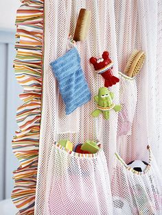 Sew an organizer for tub toys out of mesh -- and hang it out of sight behind the shower curtain.