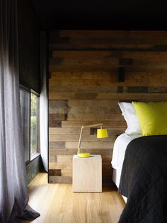 bedroom with reclaimed timber feature wall - Eltham South, Blairgowrie (designed by Wolveridge Architects)