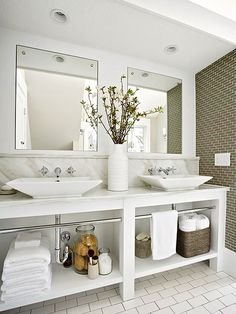 Combining the traditional look of marble with the modern vessel sink offers an up-to-date yet timeless design aesthetic. Open storage under ...