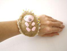 Baby hedgehog wrist pincushion beige felted wool animal pin cushion felt softie stuffed toy rusteam natural neutral upcycled eco friendly.  via Etsy.