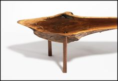 Sushi Table. Conceived by Paul White and Dan Morgan, this table is made from a single piece of walnut with a live edge. The legs are attached via a mortise-and-tenon joint technique; a sliver of maple in the dowel is visible on the table surface. The table's inception began with creating a proper table for sushi for two, sitting on the floor in the Japanese style.