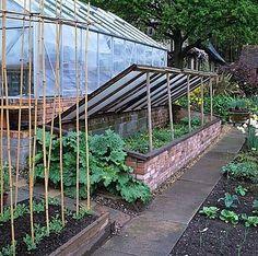 Gardener's dream... big cold frame and a pretty glass greenhouse