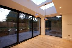 An eye catching new build in Chorleywood featuring our frameless structural glazing for an immaculate minimal, contemporary design finish.