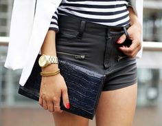 clutch and leather shorts