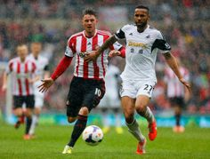 Kyle Bartley of Swansea City holds off Connor Wickham of Sunderland during the Barclays Premier League match between Sunderland and Swansea ...