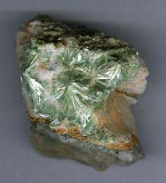 Pyrophyllite, Al2Si4O10(OH)2, Pyshminskoe deposit, Berezovskoe Au Deposit, Berezovskii, Ekaterinburg, Sverdlovskaya Oblast', Middle Urals, Urals Region, Russia. Radial spherulites of marine-green Pyrophyllite in quartz vein from the type locality. Polytype variety is Pyrophyllite 1Tc. Size 45x40x30 mm. Copyright: Pavel M. Kartashov