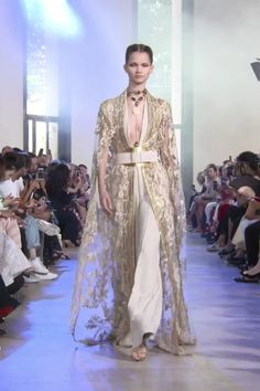 Stunning Gold Embroidered Ivory Woman's Evening Suit with Deep V-Neck Cut and Half Long Sleeves. Autumn Winter 2019/2020 Haute Couture Collection. Runway Show by Elie Saab