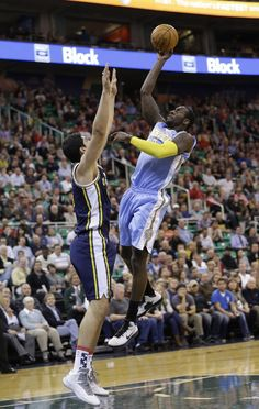 Denver Nuggets' J.J. Hickson, right, shoots as Utah Jazz's Enes Kanter, left, of Turkey, defends in the first quarter during an NBA basketball game Monday, Nov. 11, 2013, in Salt Lake City. (AP Photo/Rick Bowmer)