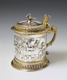 Danzig silver gilt tankard. With an embossed depiction of the wedding at Cana. Marks of Arnholt Lange, 1707 - 24.