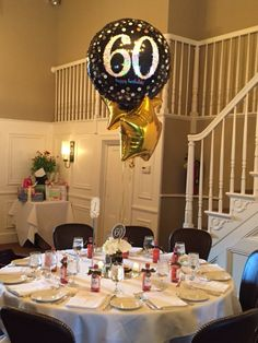 60th birthday party centerpiece in black and gold.                                                                                                                                                     More