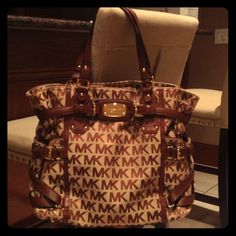 NWT! Michael Kors Gansevoort Handbag Beautiful brown, large MK handbag. Leather straps decorate the sides of purse w/ buckle details. Has a long removable strap and 2 short handles for multiple carrying options. Plaque with brand name on front. Gold hardware throughout. MICHAEL Michael Kors Bags