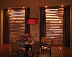 The perfect backdrop for a romantic dinner.  Pirouette® window shadings ♦ Hunter Douglas window treatments  #DiningRoom