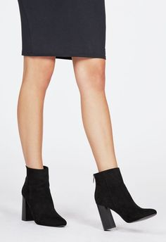 This bootie is by far our most on-trend style! With a flared block heel, faux suede construction, and inside zip, you'll have a sleek and chic style that will make your favorite outfits pop!  ...