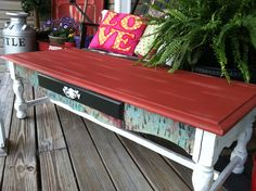 Hand painted coffee table. Can use the red paint from kitchen and cream for base.