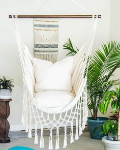 Having a great hammock or a swing in your backyard is cool, but putting one up inside your home? Now that's a refreshing way to give a new meaning to hanging out. There's something extra cozy (not to mention totally chic) about indoor hammocks and hanging chairs—it's like you can just curl up and float on cloud nine right there in your living room. No matter what your style is, from rainbows to macramé, there's a hanging retreat for everyone on this list. Hammock In Bedroom, Indoor Hammock Chair, Hammock Chair Stand, Indoor Swing, Swinging Chair, Bench Swing, Outdoor Hammock, Swing Chairs, Hammocks