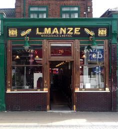 L. Manze: Walthamstow High Street Luigi Manze built and opened 76 High Street as a Pie & Mash Shop in 1929. Originally from Ravello in Italy, the Manze family emigrated to the UK in 1878. The Manze brothers went on to found an empire of 14 Pie & Mash Shops across London, particularly in the East End. Manze's remains a well known and much loved local institution and continues to serve a daily menu of pies, mash & liquer (sauce) as well as hot or cold jellied eels.