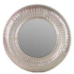 """Metal wall mirror in champagne with a textured frame.    Product: MirrorConstruction Material: Metal and mirrored glassColor: ChampagneDimensions: 35"""" Diameter x 2"""" DCleaning and Care: Wipe with clean, damp cloth"""
