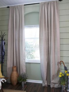 Sage Green Walls And Linen Curtains Create A Soft Neutral Setting For This Enclosed Front Porch