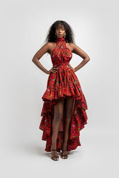 """African print infinity dress Can be worn more than 10 different ways 2 side pockets Elastic Back 100% cotton Made with high qualityAfrican print wax fabric back of the dress approx 50 inches long from waist front of the dress approx 18 inches long from waist MODEL IS 5'11 B- 34"""" W- 23"""" H- 39"""" Wearing size S-L"""
