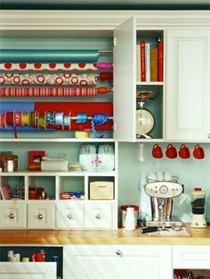 While a dedicated wrapping station is a dream for most of us, the kitchen can be the next best thing! A small counter and an empty cabinet is all you need to be super organized when you lend Santa a helping hand! Keep everything close at hand like scissors, tape, ribbon, bows and wrapping paper in this super organized, super easy kitchen project from HouseLogic! ♫ Pin the Season!