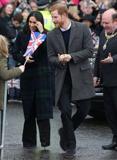Prince Harry and fiancee Meghan Markle greet crowds near Edinburgh Castle. Feb. 13, 2018