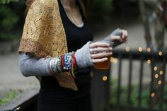 shawl... bracelets over sleeve... winter's coming