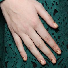 NYFW Fall 2014 Runway Edition: At Tadashi Shoji manicurist Katie Jane Hughes for butter London painted the gold metallic Marbs on the half moons and tips.