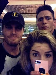 Take notice of several things. Stephen is wearing a The Flash hat. Emily has an adorable cat phone case. And lastly Colton's expression