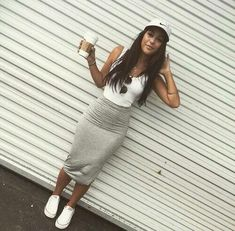 Love her style. Bodycon skirt. Converse. Nike cap. Crop top.