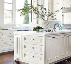 Clean white cabinets, marked by simple hardware, in the airy kitchen reflect the crisp palette carried out in the rest of the house. The light-filled space required only minor updates, such as removing some of the cabinetry. Off White Kitchens, Home Kitchens, Dream Kitchens, Traditional Interior, Modern Interior, Kitchen Interior, Kitchen Design, Kitchen Layout, Kitchen Images