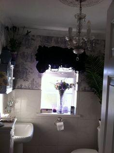 Bathroom with purple velvet blind