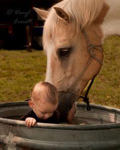 Meet Wilson.  Wilson hasn't been around children a lot.  CJ hasn't been around horses a lot.  This is the first time Wilson and CJ met. (photographer: Daryl Everett)