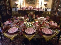 Beautiful table setting with red transferware (Mason's Vista) and cranberry glass goblets by Waterford.