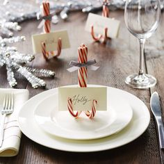 Hot glue three candy canes together for an adorable way to show your party guests where to sit.