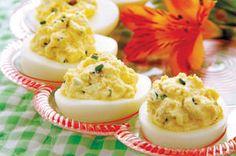 Paula Deen's take on deviled eggs uses cream cheese and mayonnaise. It's also livened up with sweet pickle relish and a dash of hot pepper sauce.